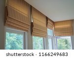brown roman blind shade curtain tree forest mountain background living room