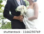 close up bride and groom hand...   Shutterstock . vector #1166250769