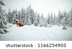 red old santa claus and winter... | Shutterstock . vector #1166254903