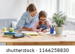 mother and child daughter doing ... | Shutterstock . vector #1166258830