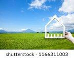 man hand holding a model house...   Shutterstock . vector #1166311003