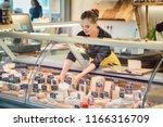 Shop Clerk Woman Sorting Chees...