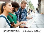young happy tourists... | Shutterstock . vector #1166324260