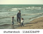 family with kids resting and... | Shutterstock . vector #1166326699