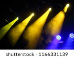 yellow and blue stage lighters... | Shutterstock . vector #1166331139