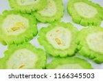 slice of bitter melon or bitter ... | Shutterstock . vector #1166345503