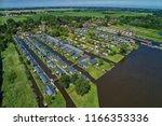 aerial view of giethoorn... | Shutterstock . vector #1166353336