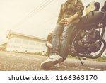 biker man with his motorbike... | Shutterstock . vector #1166363170