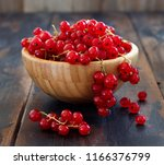 Small photo of Ripe red currant berries in a bowl cloe up
