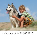 Boy Hugging A Fluffy Dog. Husky ...