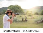 young man traveler and... | Shutterstock . vector #1166392963