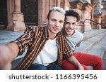 portrait of beaming guys taking ... | Shutterstock . vector #1166395456
