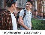 optimistic male telling with... | Shutterstock . vector #1166395549