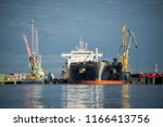 close up of the cargo ship in... | Shutterstock . vector #1166413756