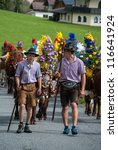 FIEBERBRUNN, AUSTRIA - SEPT 15: Two farmer boys at Traditional Almabtrieb. A ceremonial driving down of cattle from the mountain into valley in autumn in Fieberbrunn, Austria on September 15, 2012. - stock photo