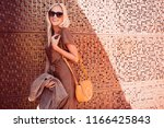 fashionable woman walking in... | Shutterstock . vector #1166425843
