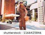 fashionable woman walking in... | Shutterstock . vector #1166425846