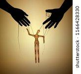 fate concept  wooden marionette ... | Shutterstock .eps vector #1166428330