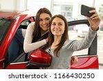 beautiful and cute girls making ... | Shutterstock . vector #1166430250