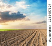 plowed field and sunset in low... | Shutterstock . vector #1166457829