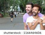 multiethnic gay couple in the... | Shutterstock . vector #1166464606