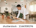 focused young asian businessman ... | Shutterstock . vector #1166508196