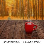 autumn leaves and hot steaming... | Shutterstock . vector #1166545900
