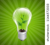 bulb with green sprout sunburst ... | Shutterstock . vector #1166572033