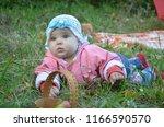portrait of happy little baby... | Shutterstock . vector #1166590570