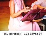 golden blues. man's male hands... | Shutterstock . vector #1166596699