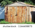 old and rusty metal double gate ... | Shutterstock . vector #1166608873