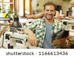 young bearded male worker ... | Shutterstock . vector #1166613436