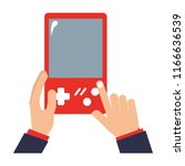 hands with video game portable...   Shutterstock .eps vector #1166636539