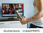 man watches tv news report... | Shutterstock . vector #1166699893