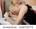sick young woman leaning on... | Shutterstock . vector #1166720773