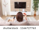 single woman eating pizza and...   Shutterstock . vector #1166727763