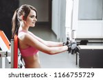 attractive woman working out on ... | Shutterstock . vector #1166755729