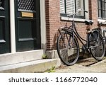 retro style bicycle parked near ...   Shutterstock . vector #1166772040