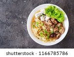 vegan noodle soup with tofu... | Shutterstock . vector #1166785786