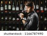 sommelier smelling flavor of... | Shutterstock . vector #1166787490