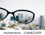 close up of spectacles on... | Shutterstock . vector #1166821309