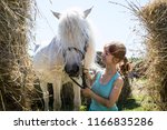 Girl With A Horse Near The Hay...