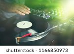 party dj plays music in bright... | Shutterstock . vector #1166850973