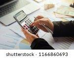 business woman using calculator ... | Shutterstock . vector #1166860693