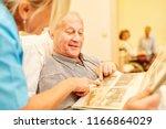 senior man with dementia looks... | Shutterstock . vector #1166864029