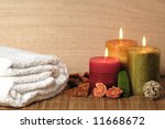 bath towel and aromatic candles - stock photo