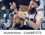 dedicated male hairstylist... | Shutterstock . vector #1166887273
