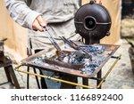 the blacksmith forge.... | Shutterstock . vector #1166892400