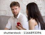 decisive girlfriend making... | Shutterstock . vector #1166893396