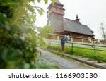 old wooden church in mountains... | Shutterstock . vector #1166903530
